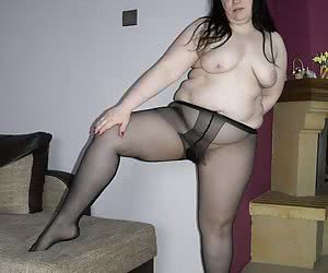 Little chubby wife spreads her cute legs in black sheer pantyhose