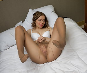 Lustful girl shows her pussy through her large size pantyhose