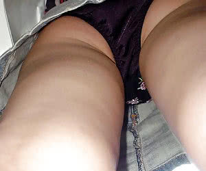 A pantyhosed lady in outdoor upskirt shots